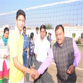 Principal Sir greeting and encouraging players...