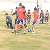 Football match.. Students playing hard to win...